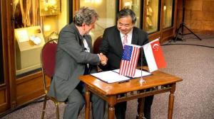 NTU Provost Professor Freddy Boey (right) and Smithsonian's Interim Under Secretary for Science Dr W. John Kress (left) sealing the partnership at Smithsonian Castle in Washington, DC, United States. -- PHOTO: NTU