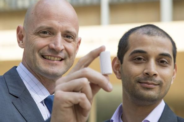 J.R. DeShazo, left, and Gaurav Sant show off a sample of the new building material they have created to replace concrete. Credit: UCLA